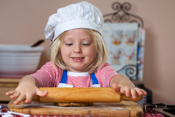 Cute young boy baking