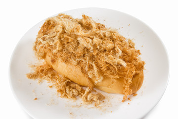 Bread with dried shredded pork isolated on dish