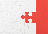 Incomplete white puzzle with red color background with copyspace poster