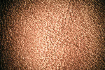 Brown textured leather grunge background closeup