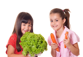 cute little girls with vegetables
