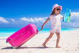 Fototapety Little adorable girl with big colorful suitcase and a map in