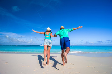 Young romantic couple have fun at Caribbean tropical beach