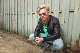 young bearded man crouching outdoor