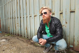 crouched young bearded man