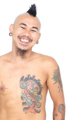 smiling asian punk guy isolated on a white background
