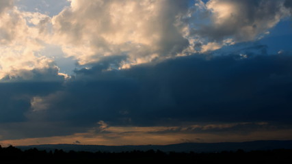 Beautiful timelapse of clouds sunrise sky with solar rays.