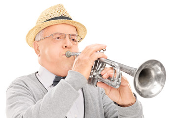 Senior musician playing a trumpet