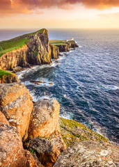 Vertical view of Neist Point lighthouse with rocks foreground, S