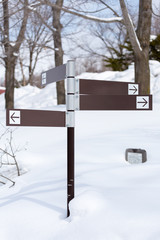 Blank direction signs in snow
