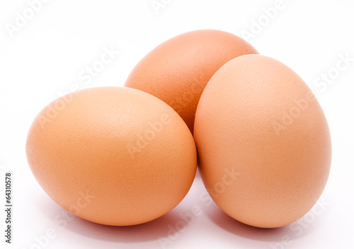 Foto op Canvas Egg Three brown chicken eggs isolated on a white background