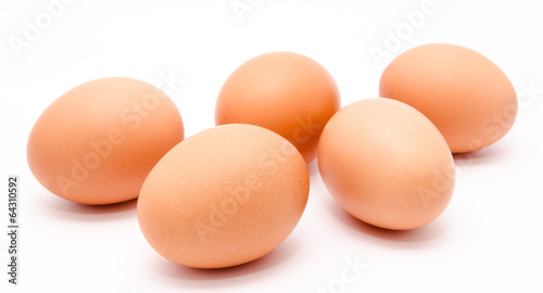 Five brown chicken eggs isolated on a white background - 64310592