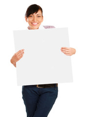 Beautiful young woman holding empty white board.
