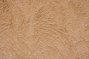 Orange rough plaster on wall