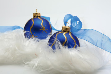 Traditional Christmas ball ornaments with ribbons on white