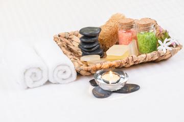 Balt salt, loofah and stones in a banana leaf basket