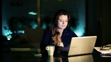 Sleepy woman finish web surfing on laptop and go to sleep