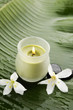 frangipani and candle on banana leaf texture