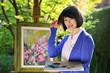 Beautiful asian girl painting outdoor