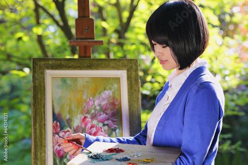 Beautiful girl painting oudoor
