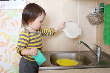 baby washing dishes