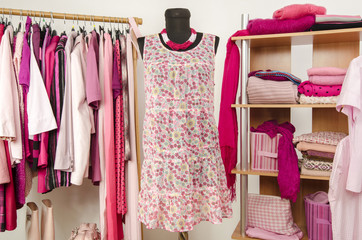 Dressing closet with pink clothes, close up on the mannequin.