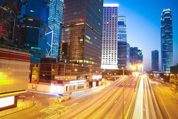 The highway trails light  on modern landmark building background