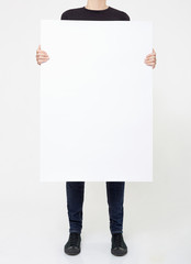 Man holding blank panel billboard on white, clipping path