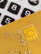 Goldene Kreditkarte und Taschenrechner