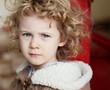 Closeup portrait of serious caucasian little girl