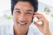 Smiling man on phone call