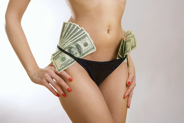 Female perfect sexy body and dollar banknotes money