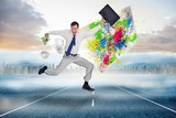 Image of cheerful jumping businessman with his suitcase