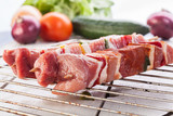 Raw shashlik and vegetables