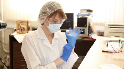 Woman scientist with pipette in the lab