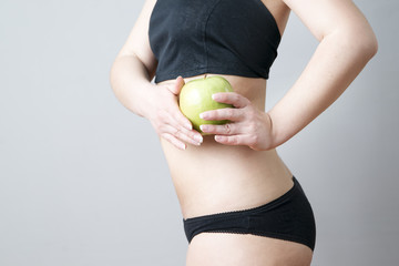 Female body with green apple