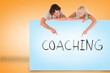 Attractive couple showing card with coaching