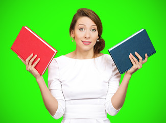 Which book? Confused woman holding two different books