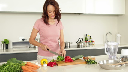 Pretty woman chopping vegetables
