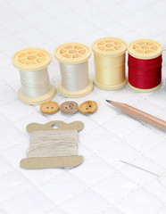 Needlework accessories put on Patchwork Quilt