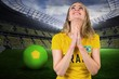 Composite image of nervous football fan in brasil tshirt