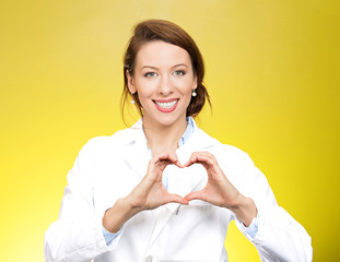 Smiling, happy health care professional, nurse making hand heart