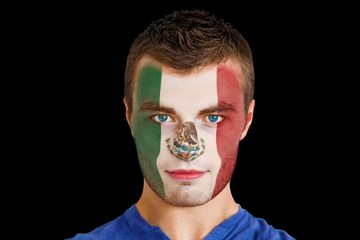 Composite image of serious young mexico fan with facepaint