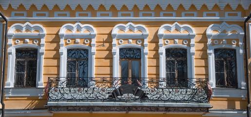 windows and  beautiful balcony with openwork lattice