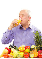 Mature man drinking juice