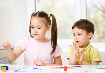 Children are painting with paint
