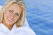 Woman Girl in White Spa Robe Blue Water Background