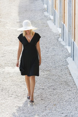 Beautiful Woman in Hat & Black Dress