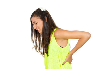 Young woman with back pain, ache on white background