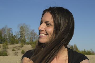 Satisfied beautiful woman in the evening sun - meditation
